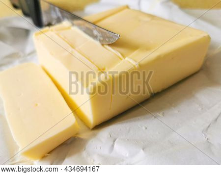 Sliced butter Pieces With Knife On A Table