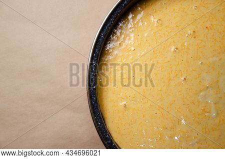 Concept Homemade Fall Baking With Pumpkin And Food Ingredients. Cooking Pumpkin Pie. Mixed Dough Wit