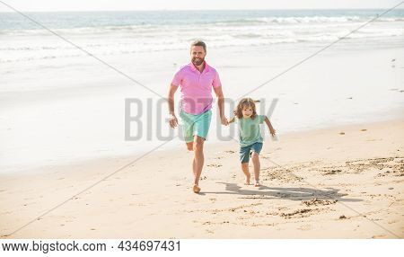 Fathers Or Family Day. Daddy With Kid Boy On Summer Day. Dad And Child Having Fun Outdoor