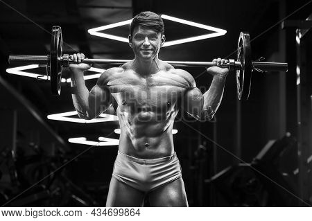 Athletic Man Pumping Doing Lunges Exercises In Gym