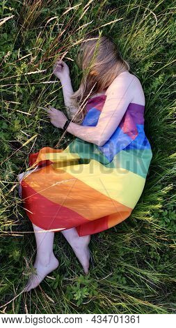 Lesbian Naked Woman Lying On Lgbt Flag On Grass Outdoor . Support Of Non-traditional Orientation In