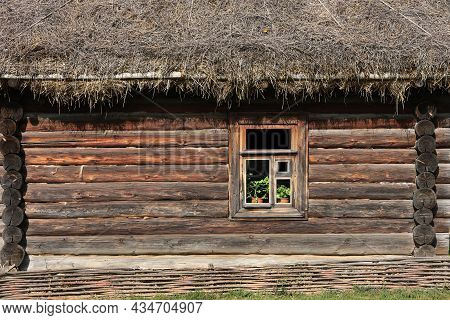 Full Frame Background And Texture Of Traditional Russian Log House With Straw Roof And One Window Un