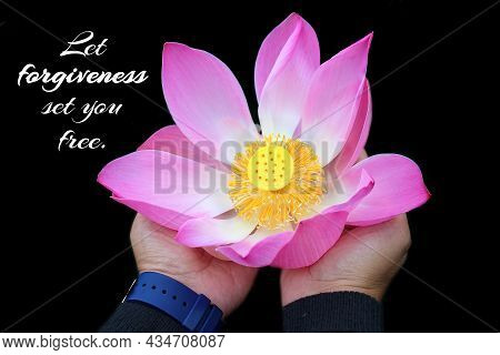 Inspirational Quote - Let Forgiveness Set You Free. With Woman Holding A Pink Lotus Flower Blossom I