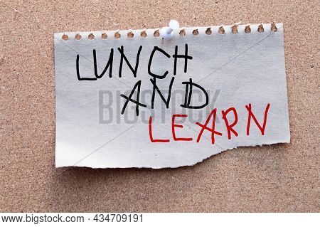 Lunch And Learn, A Spiral Notepad That Has The Words Lunch And Learn Over A Distressed Wood Backgrou