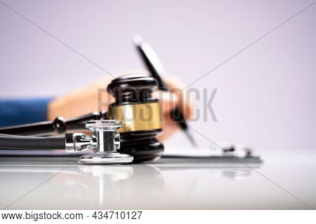 Malpractice Case In Courtroom. Gavel And Stethoscope