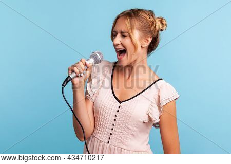 Profile Of Young Adult Female Wearing Summer Dress Singing Loudly In Karaoke, Talented Woman Sings F