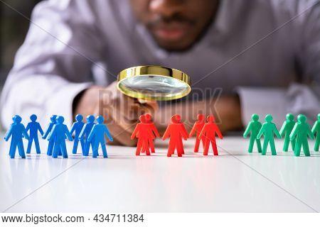 Business Customer Market Segment. Pawns Under Magnifier Glass