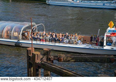 Berlin Germany - August 26 2017; People On-board River Boat On River Spree In City Enjoying Early Ev