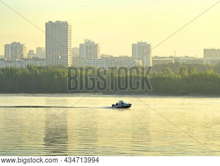 Boat On The Water. Built-up Bank Of The Great Siberian River Ob In The Morning Fog