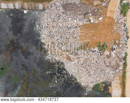 Aerial Shot Of Drone Of Plastic Waste That Were Left Piled Up Near The Water Source Causing Environm