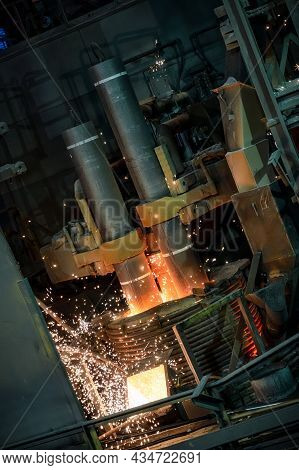 Electric Arc Steelmaking Furnace, Thick Powerful Red-hot Graphite Electrodes.