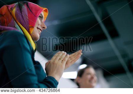 Ambassador arabian woman clapping her hands
