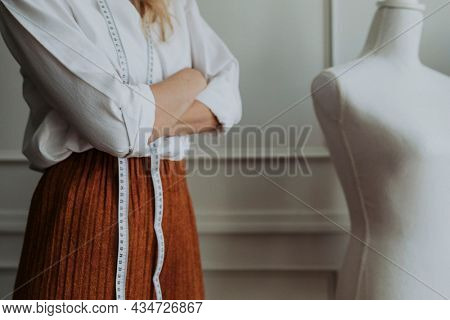 Confident woman in fashion industry standing with arm crossed