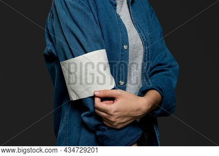 Blank volunteer armband on a denim jacket closeup