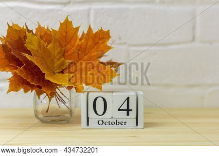 October 4 On The Calendar And A Bouquet Of Bright Autumn Leaves On The Table.one Of The Days Of The