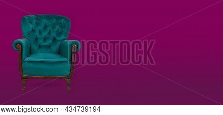 Elegance Teal Armchair On A Maroon Background. Copy Space For Text - Banner.