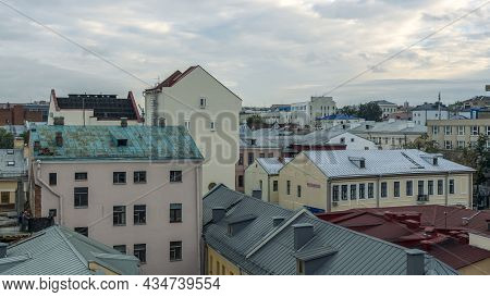 Tile Roofs Over Historical City Center. Top View Of The Historic Part Of Minsk, Belarus. Travel Conc