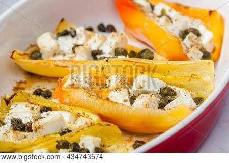 baked yellow peppers with feta cheese and capers