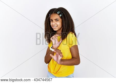 Young african american girl standing over white isolated background disgusted expression, displeased and fearful doing disgust face because aversion reaction. with hands raised