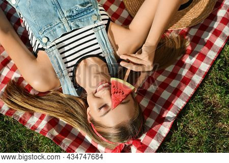 Beautiful Girl With Piece Of Watermelon On Picnic Blanket Outdoors, Top View