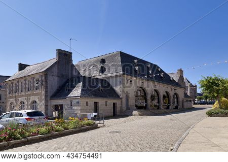 Guerlesquin, France - September 06 2021: The Market Hall Is A Granite Building Built In 1882 Which H