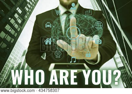 Text Sign Showing Who Are You Question. Word Written On Asking Person Identity Or Personal Informati