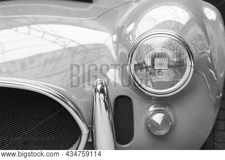 Black And White Photo With Round Headlight Of Old Retro Car On Black And White Background In Style O