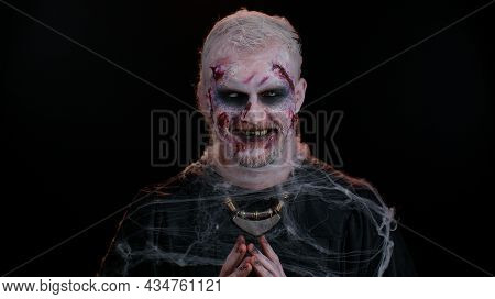 Cunning Sly Sinister Man In Carnival Costume Of Halloween Crazy Zombie With Bloody Wounded Scars Fac