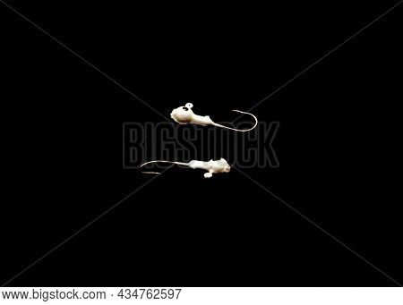 Two Jig Head Hooks With Round Walleye Isolated On Black Background