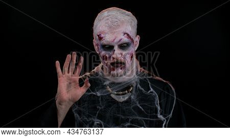 Hello, Hi. Scary Man With Bloody Scars Face, Halloween Zombie Make-up. Scary Wounded Undead Guy Wave