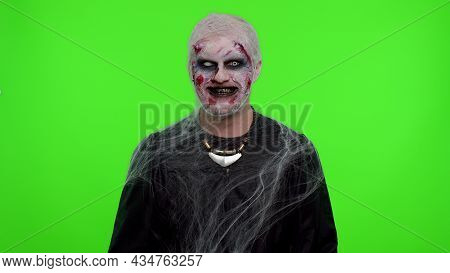 Cheerful Happy Terrified Man Bloody Scars Face, Halloween Stylish Zombie Make-up. Scary Wounded Unde