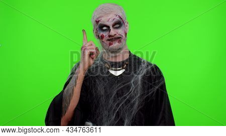 Eureka. Inspired Sinister Man Halloween Crazy Zombie With Bloody Wounded Scars Face Make Gesture Rai