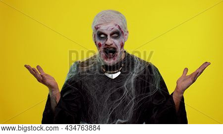 Oh My God, Wow. Frightening Man With Halloween Zombie Bloody Wounded Makeup Raising Hands In Surpris