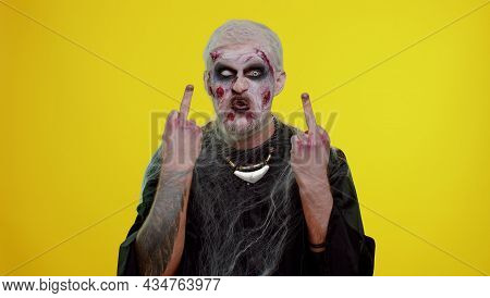 Aggressive Crazy Hooligan Halloween Zombie Man With Makeup With Wounds Scars Showing Around His Midd