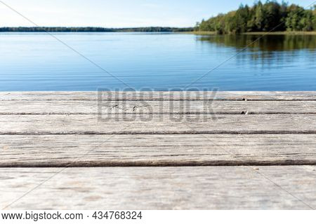 Pier On The Lake.wooden Bridge Forest In Spring Autumn Time With Blue Lake. Lake For Fishing With Pi