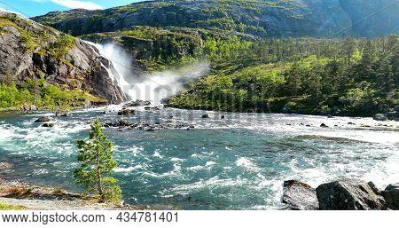 Kinsarvik, Hordaland, Norway. Waterfall Nykkjesoyfossen In Hardangervidda Mountain Plateau. Spring S