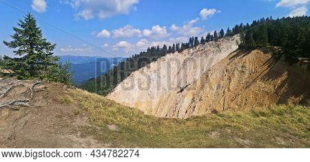 Erodated Soil At Ruginoasa Abyss. Groapa Ruginoasa In Apuseni Mountains, Natural Monument, Alpine Tr