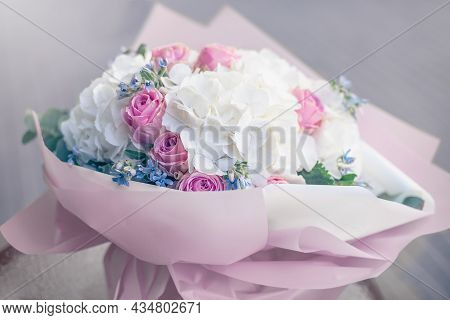 Bouquet Flowers Background White Hydrangea Flowers And Pink Roses. Texture, Top View, Close Up. Bloo