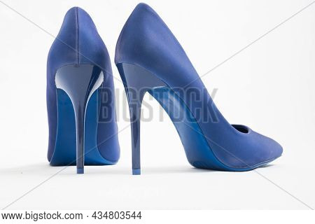 A Pair Of Blue High-heeled Shoes. Suede Womens Elegant Shoes On A White Background. Beautiful High A