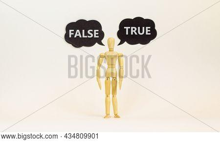 True Or False Symbol. Wooden Model Of Businessman Human. Black Paper With Words 'true False'. Beauti