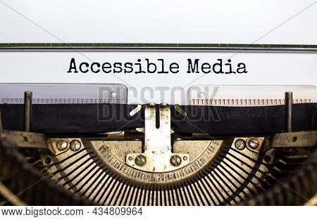 Accessibility And Accessible Media Symbol. Concept Words 'accessible Media' Typed On Old Retro Typew