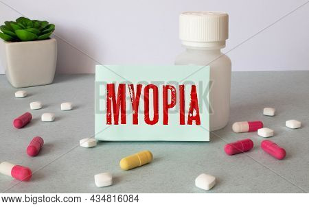 Myopia Word Written On Label Tag With Stethoscope On Wood As Medical Concept