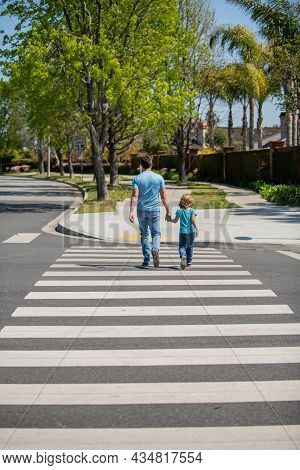 Father And Son Walk On Zebra Crossing. Family Value. Parent Leading Small Child Boy