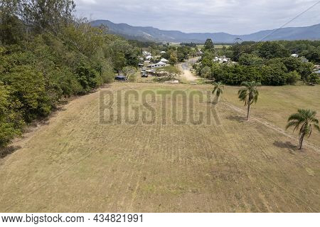 Aerial Landscape Over A Grassy Park Towards The Township Of Finch Hatton, Queensland, Australia