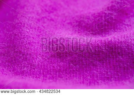 Background Texture Of Pink Pattern Knitted Fabric Made Of Angora Or Wool. Close Up.