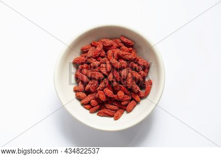White Bowl Of Red Dried Goji Berries Isolated On White Background And Copy Space, Top View.