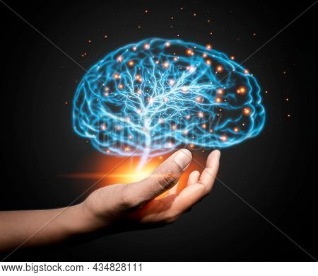 Hand Holding Glowing Brain On Dark Background. Ai Network Of Brain On Business Analysis, Innovative