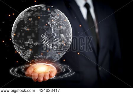 The Businessman Reached Out With A 3D Globe In His Hand. Concept To The Search For Clean Energy To R