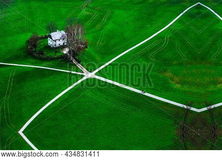 Aerial View Of A House In The Field Surrounded By Green Grass, View Of A Lonely House In The Green F