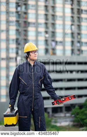 Asian Maintenance Worker Man Wearing Protective Suit And Helmet Holding Red Aluminium Spirit Level T